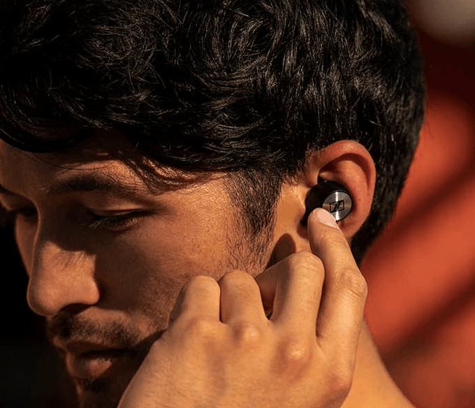 Wearing Momentum Ear Buds