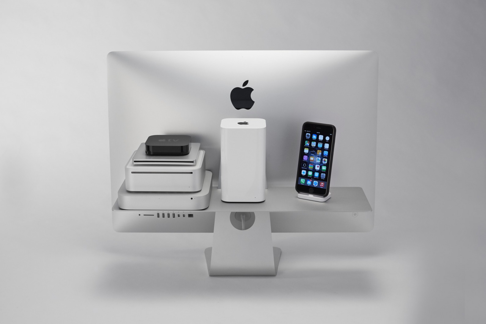 If You Re Looking For An Elegant Solution To Freeing Up Some Desk E While Giving Your Imac A Real World Task Of Holding Items On Behalf