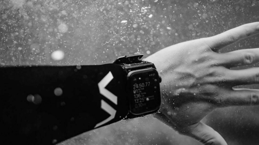 arm with active watch strap on wrist underwater
